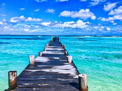 image of pier out over mexico water and beach